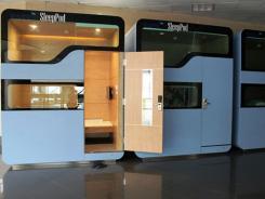 Des cabines-lits pour dormir à l'aéroport de Hanoï